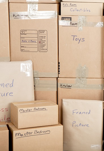 Wall with boxes labeled and ready for shipping, professional packers and movers